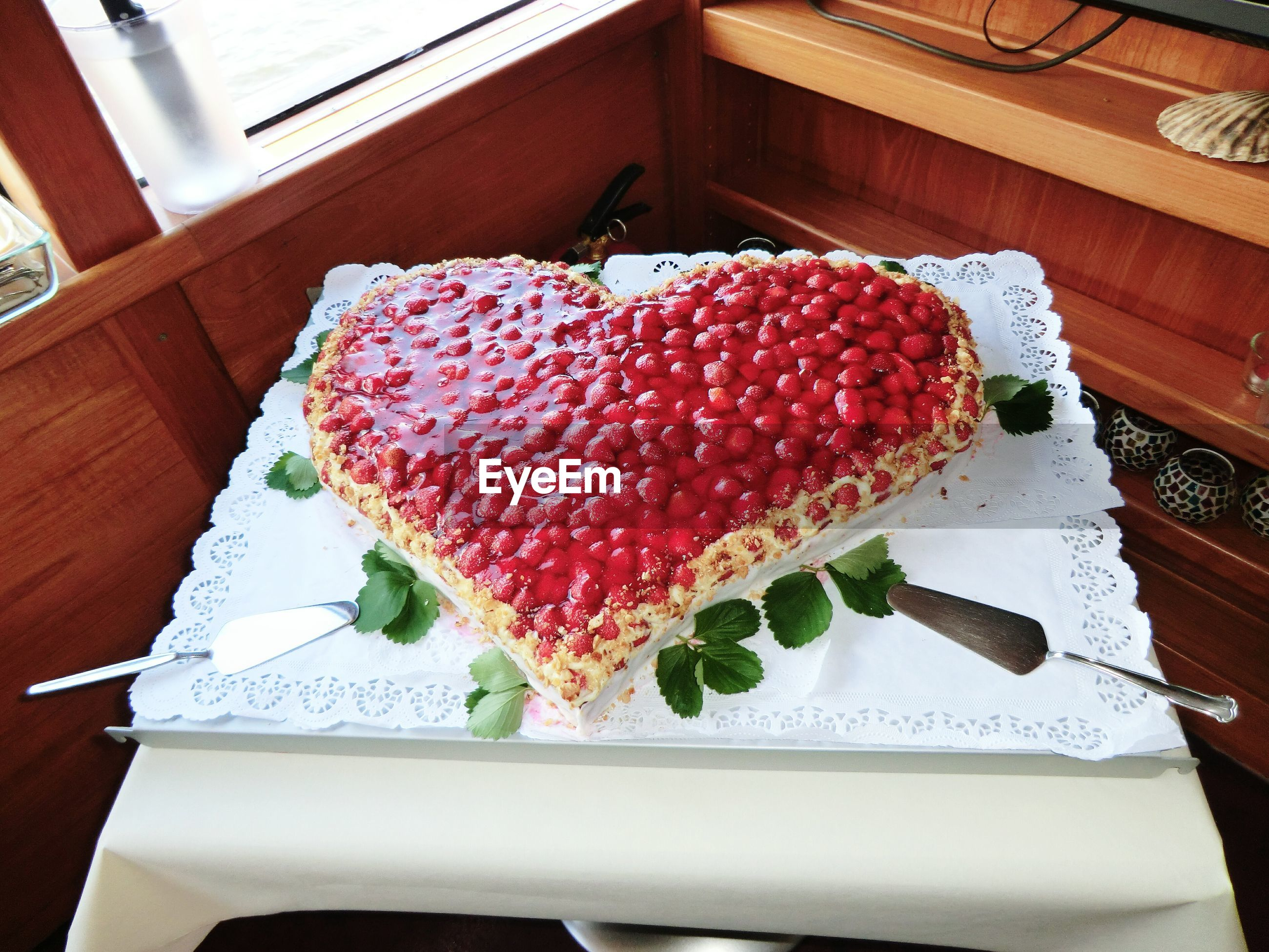 High angle view of heart shape cake served on table