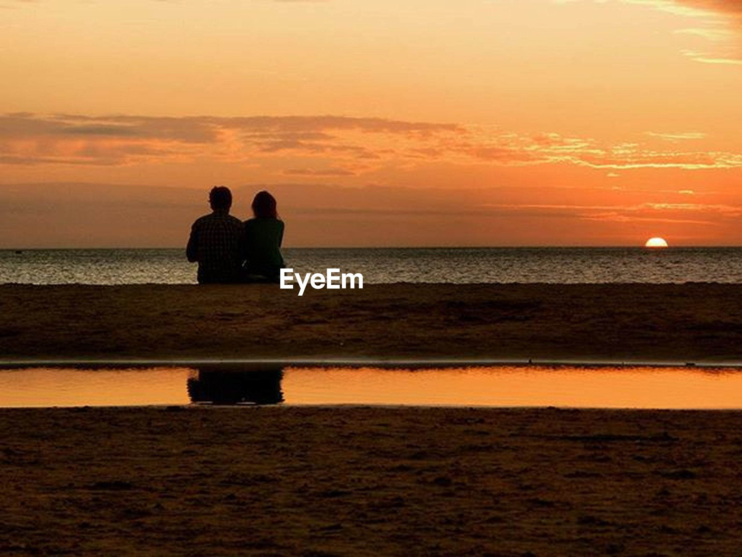 sea, sunset, horizon over water, water, silhouette, orange color, scenics, sky, beauty in nature, tranquil scene, tranquility, idyllic, nature, men, leisure activity, lifestyles, beach, standing