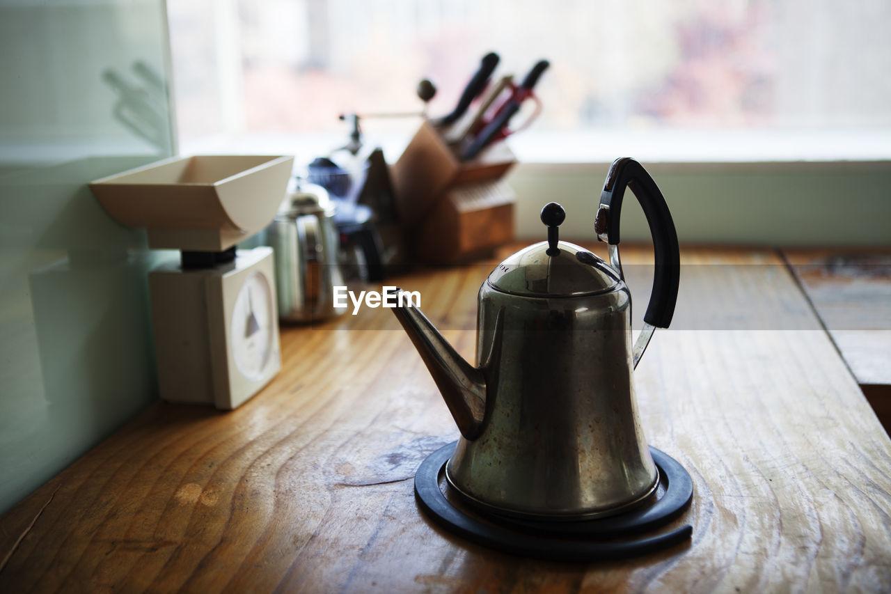Metallic Teapot At Kitchen Counter