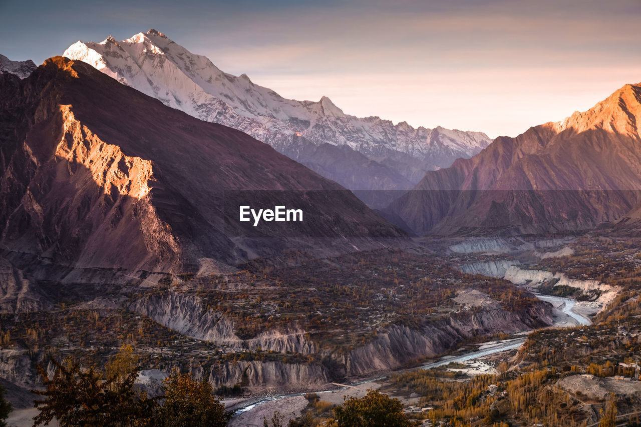 mountain, sky, scenics - nature, mountain range, environment, beauty in nature, rock, tranquil scene, landscape, nature, tranquility, non-urban scene, cold temperature, snow, idyllic, no people, sunset, rock - object, remote, mountain peak, formation, outdoors, snowcapped mountain, eroded, arid climate