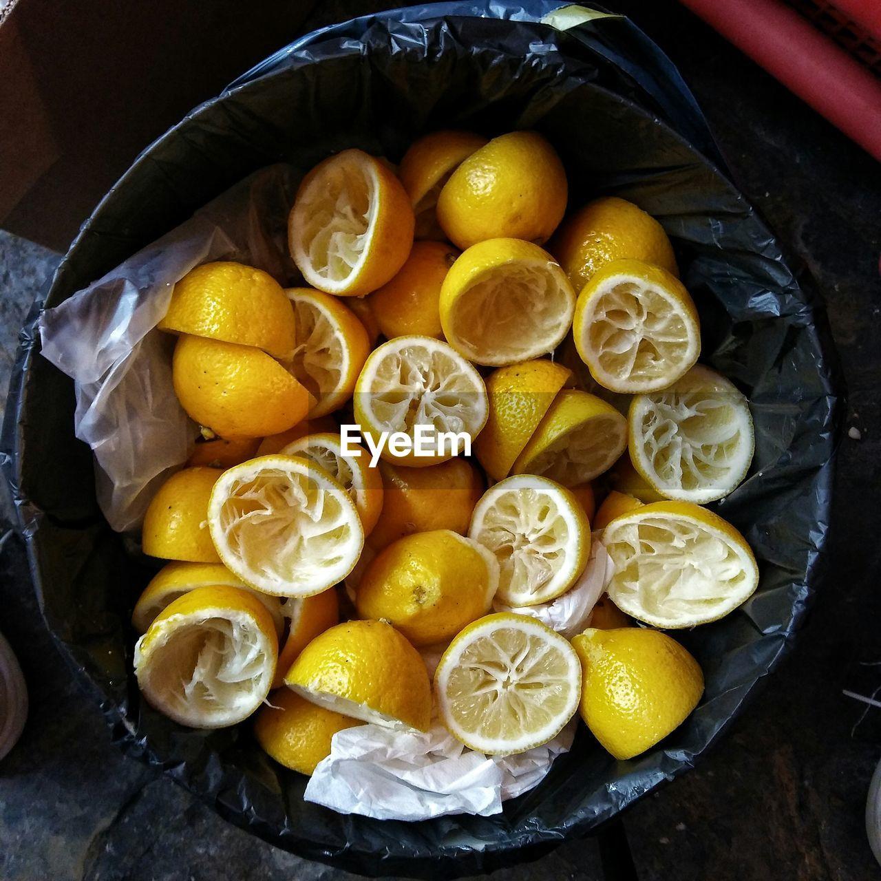 Directly Above Shot Of Sliced Lemons In Garbage Bin