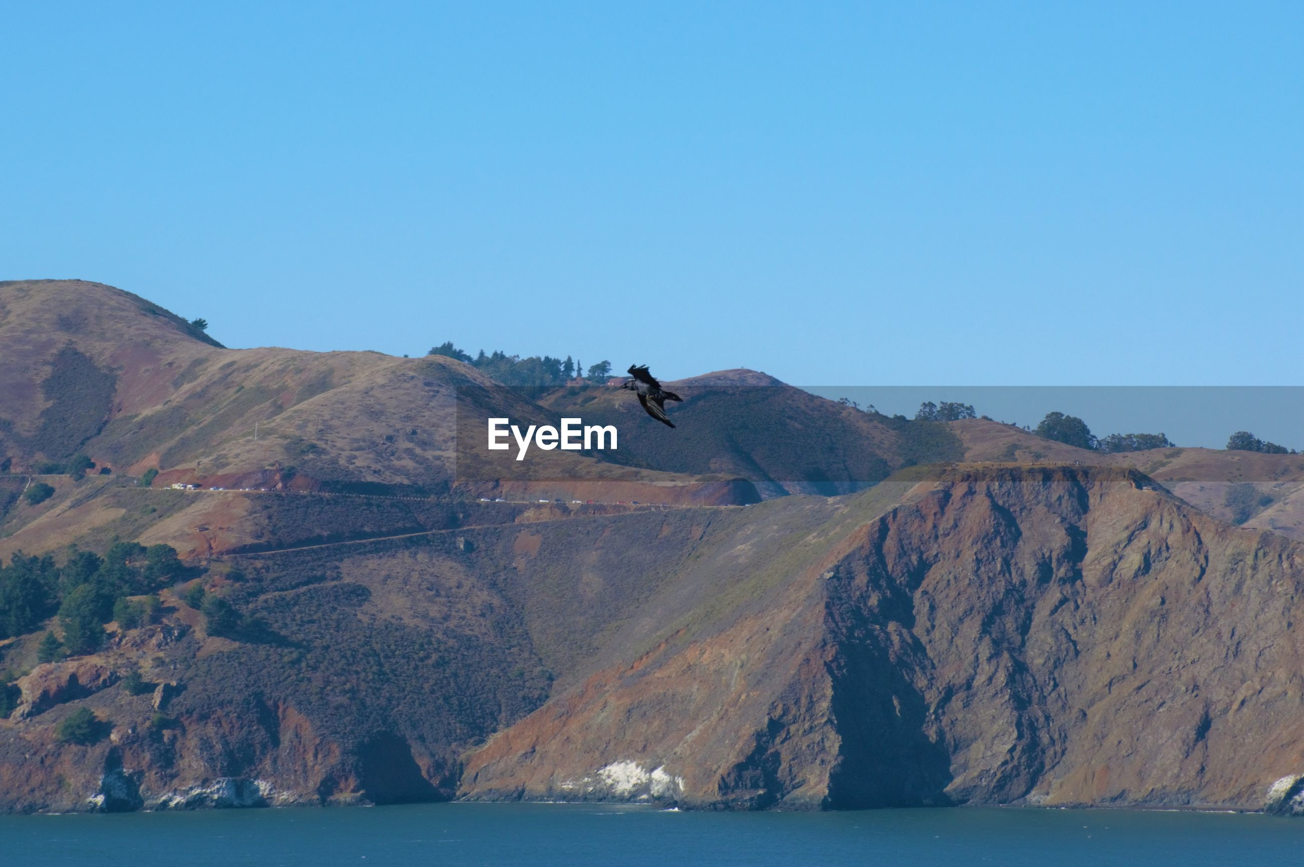 Scenic view of the columbia river and mountains against clear blue sky