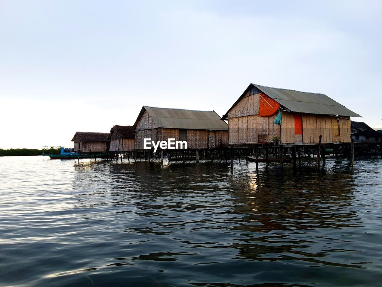 built structure, architecture, water, stilt, waterfront, building exterior, house, stilt house, outdoors, tranquility, no people, rippled, sky, day, houseboat, lake, nature