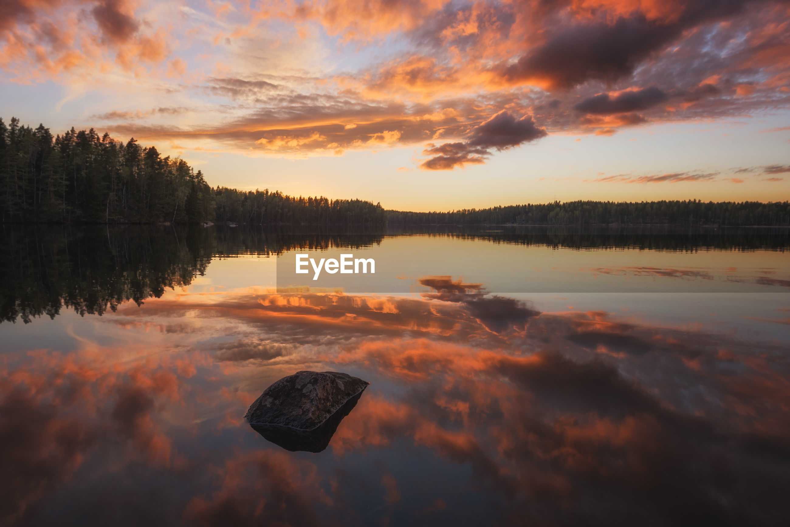 Scenic view of sunset sky over water