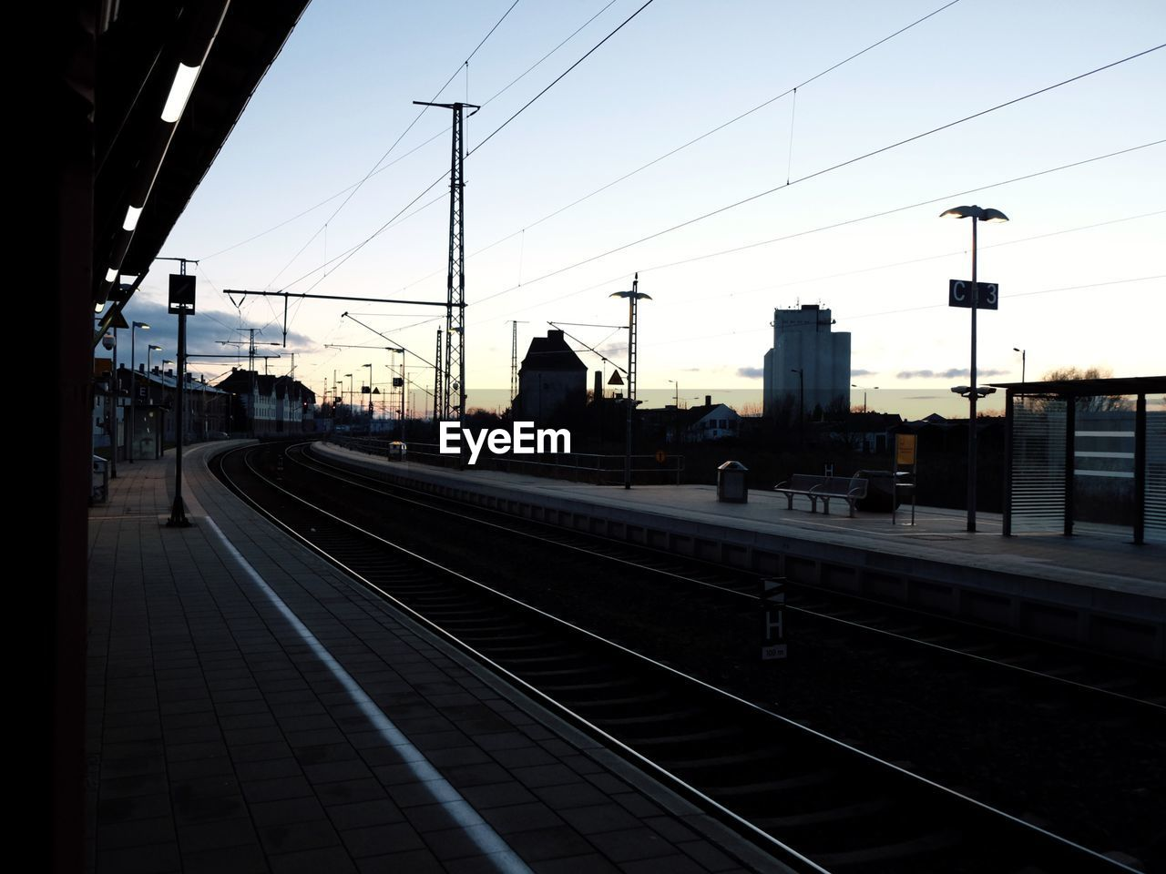 View Of Railroad Station Platform At Dusk