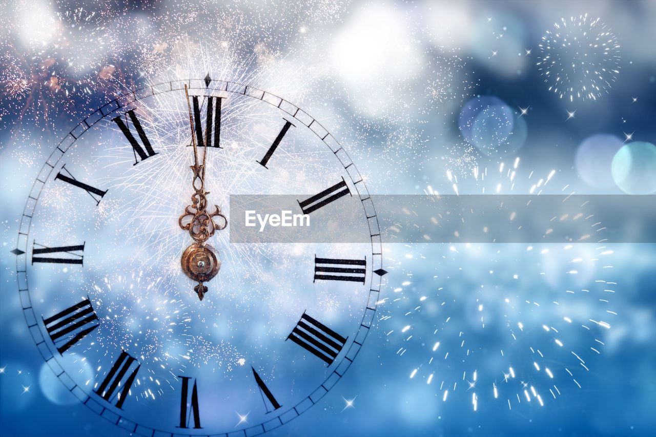 clock, time, no people, illuminated, roman numeral, shape, clock face, low angle view, roman, circle, minute hand, geometric shape, sky, motion, close-up, celebration, nature, indoors, instrument of time, night, new year's eve