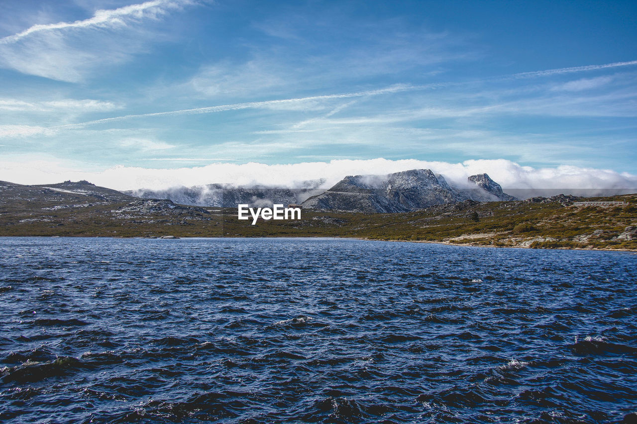 mountain, nature, beauty in nature, scenics, tranquility, waterfront, cold temperature, sky, outdoors, day, tranquil scene, blue, mountain range, water, snow, no people, landscape, lake, winter, iceberg