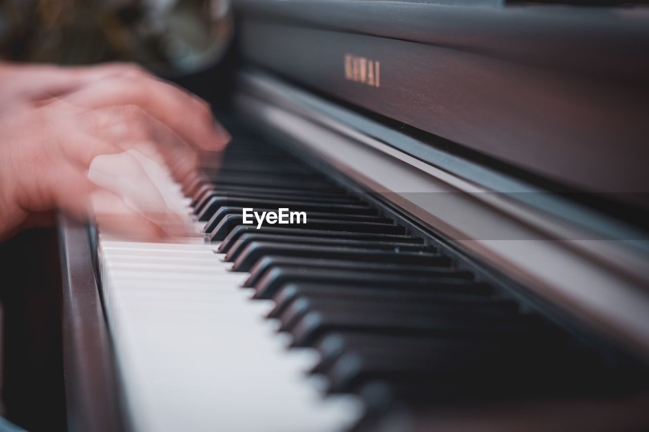 Blurred Motion Of Hands Playing Piano