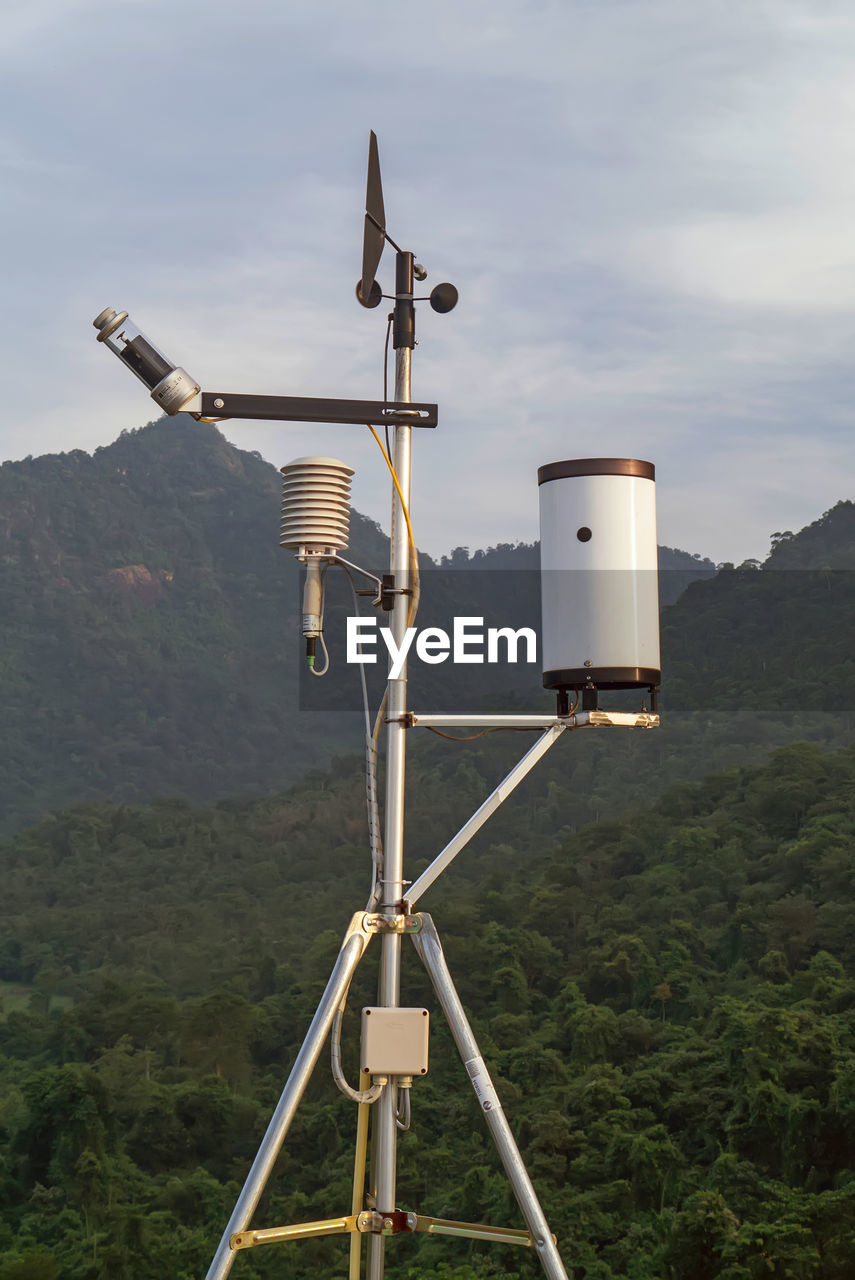 sky, technology, mountain, nature, day, no people, outdoors, surveillance, tree, communication, plant, scenics - nature, environment, cloud - sky, non-urban scene, security camera, security, metal, landscape, focus on foreground