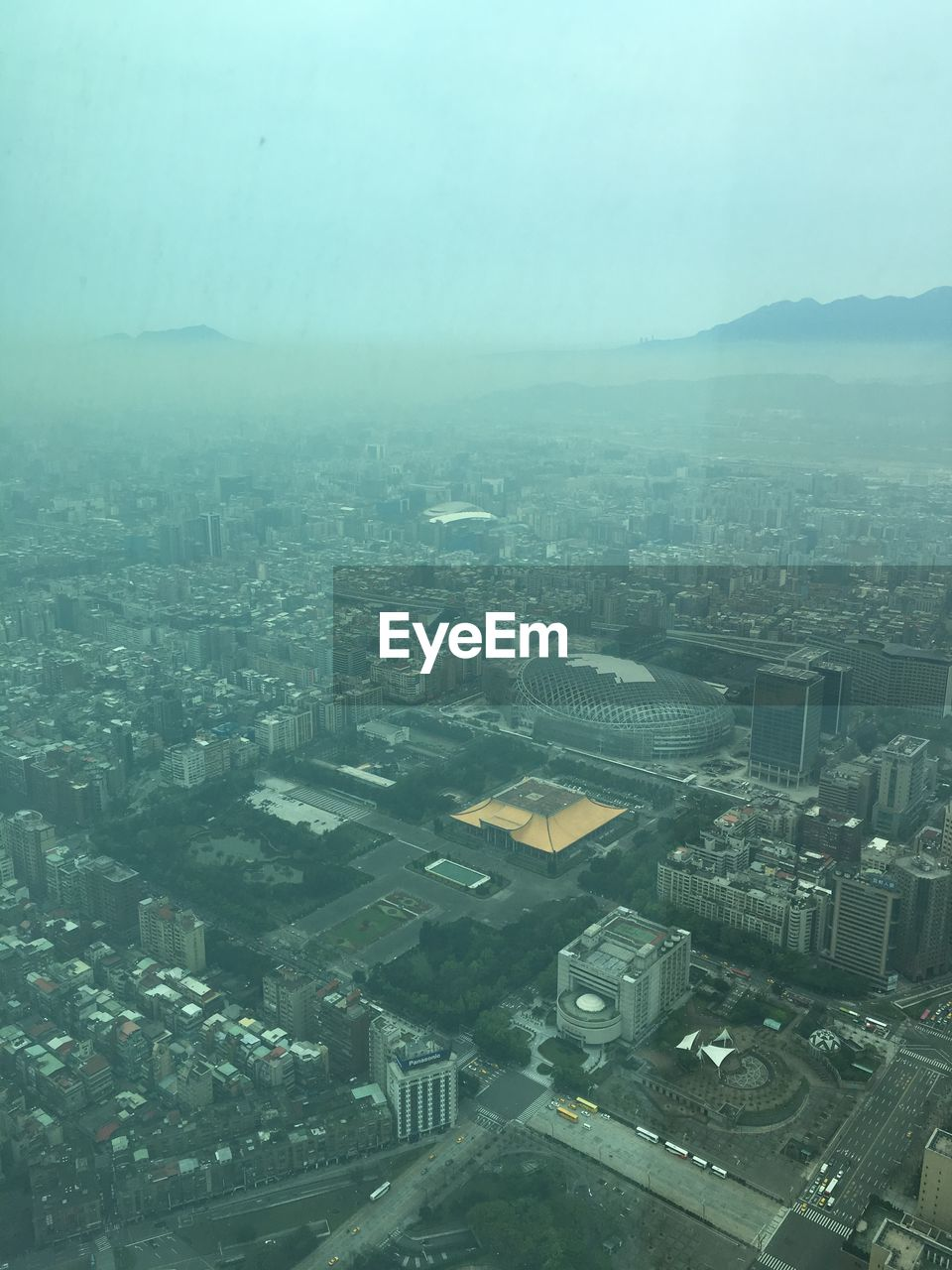 city, building exterior, architecture, built structure, cityscape, building, no people, sky, high angle view, nature, residential district, aerial view, outdoors, day, fog, environment, transparent, skyscraper, office building exterior