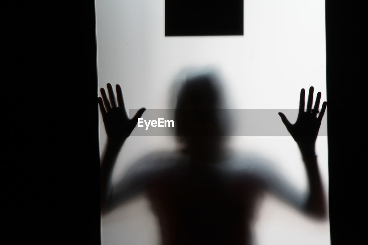 Man Seen Through Frosted Glass