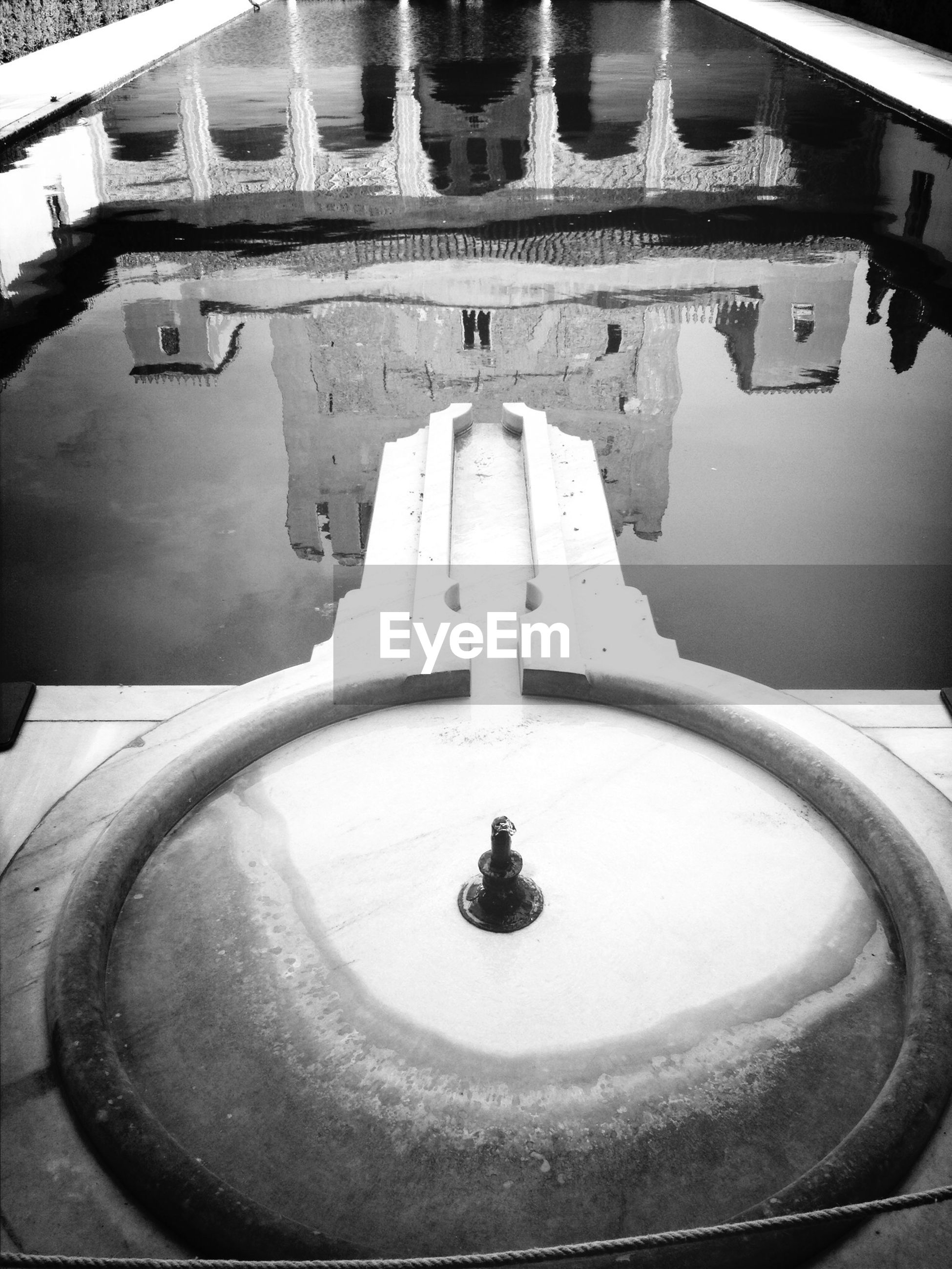 architecture, built structure, water, building exterior, high angle view, reflection, fountain, building, day, no people, history, outdoors, puddle, sculpture, old, transportation, travel destinations, travel, famous place, place of worship
