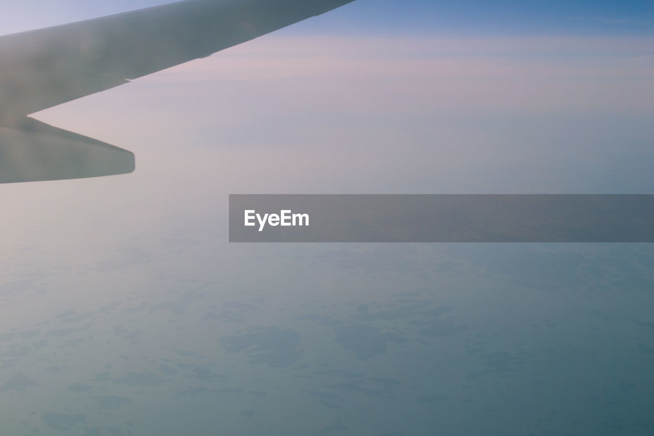 water, nature, outdoors, no people, beauty in nature, scenics, day, sky, tranquility, aerial view, airplane, airplane wing, close-up