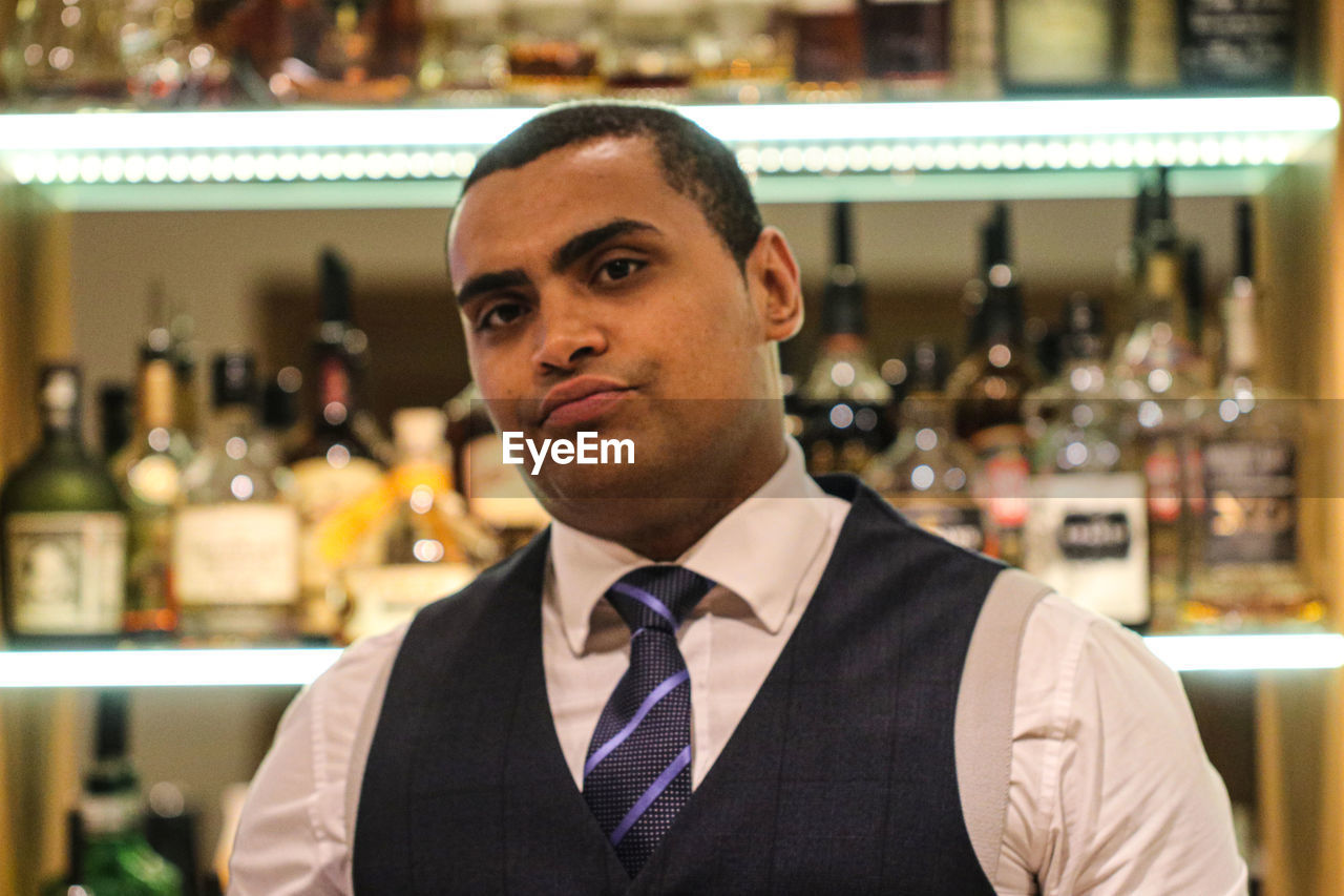 Close-up portrait of man in bar