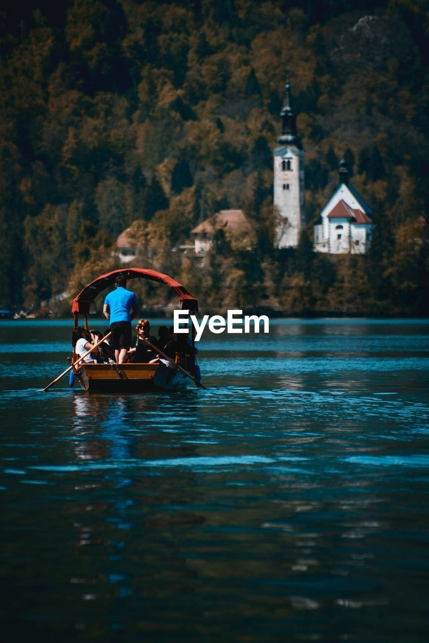 People On Boat Sailing In Lake Bled