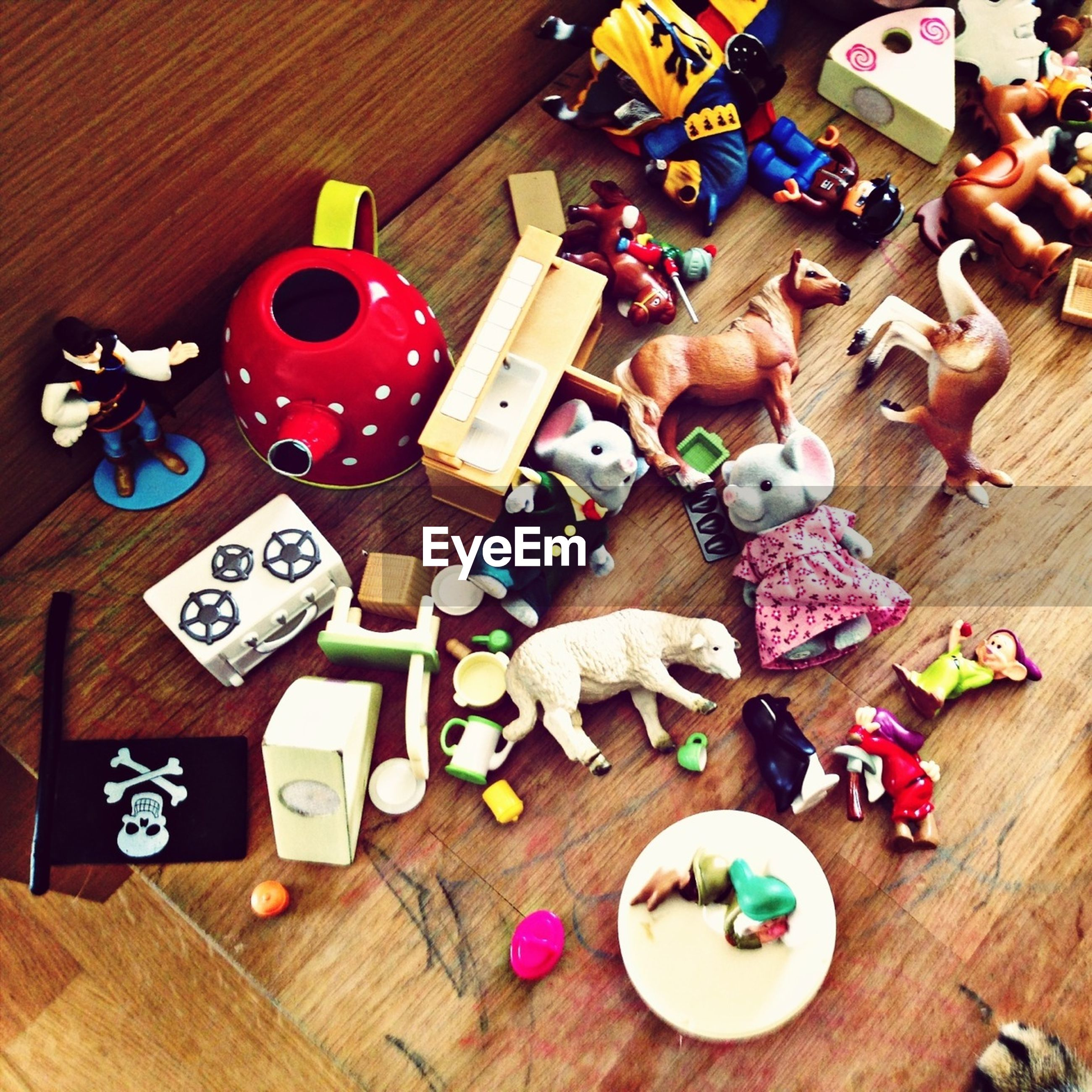 indoors, table, high angle view, wood - material, variation, large group of objects, still life, multi colored, arrangement, wooden, abundance, choice, directly above, toy, collection, close-up, childhood, creativity, no people, art and craft