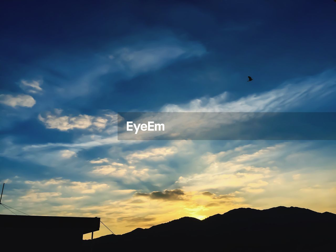 silhouette, sky, flying, cloud - sky, sunset, low angle view, nature, outdoors, mid-air, scenics, beauty in nature, built structure, no people, bird, architecture, day
