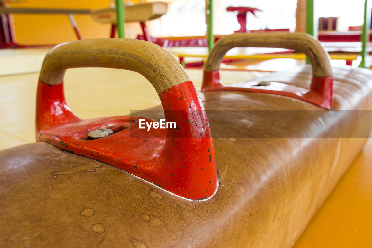 Close-up of pommel horse in gym