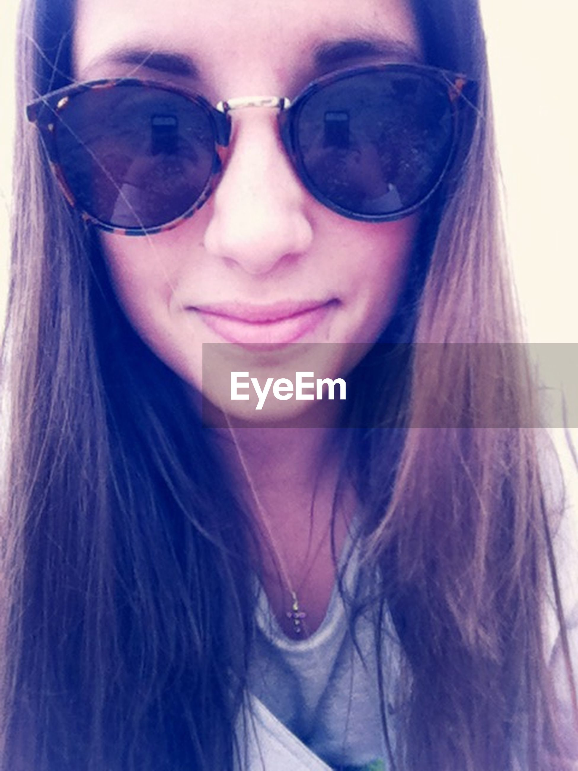 sunglasses, lifestyles, leisure activity, person, young adult, headshot, close-up, young women, reflection, eyeglasses, front view, looking at camera, long hair, portrait, transparent, human face, smiling