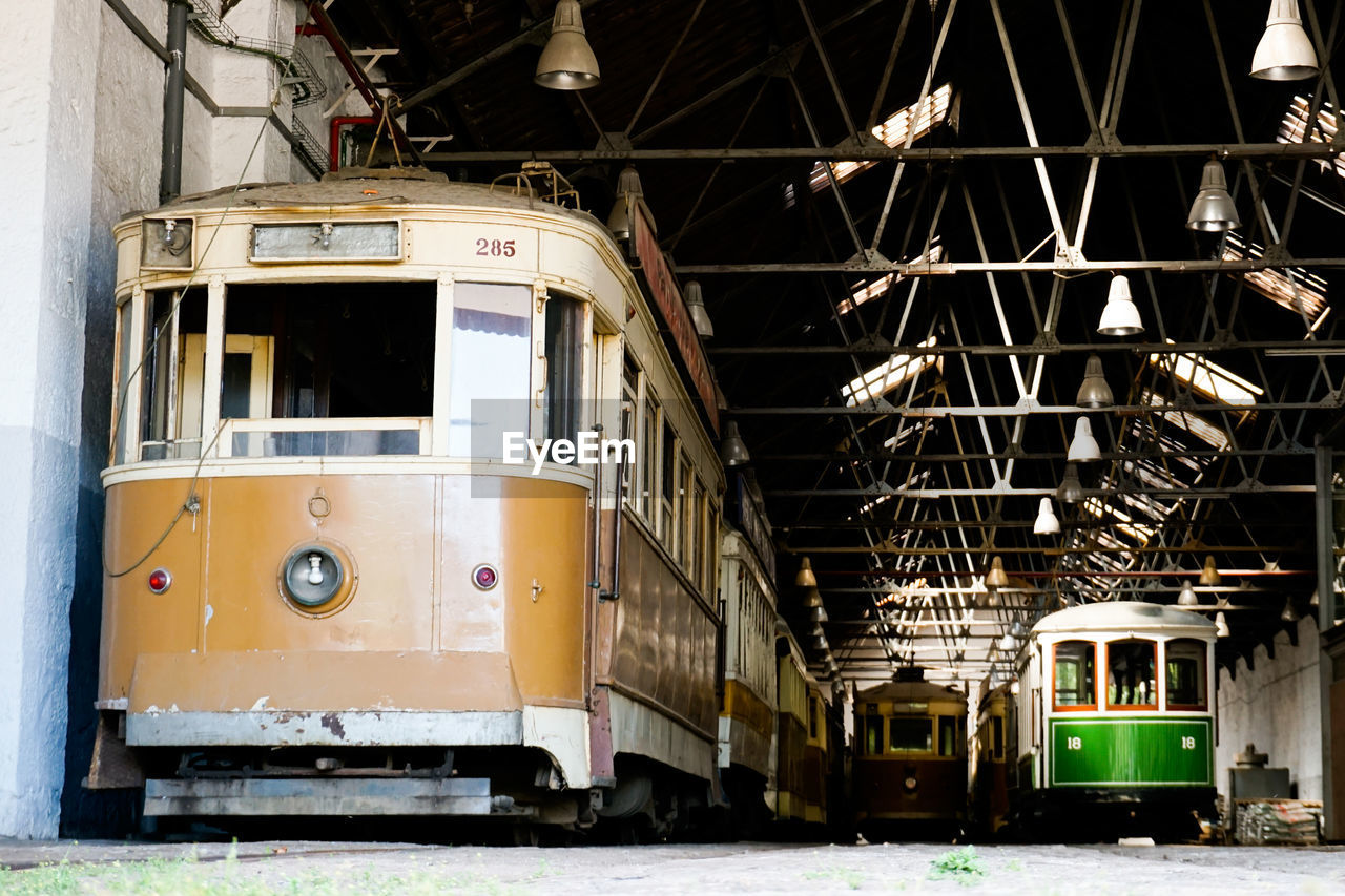 mode of transportation, public transportation, transportation, rail transportation, train, no people, architecture, train - vehicle, built structure, outdoors, land vehicle, illuminated, stationary, railroad track, track, metal, nautical vessel, abandoned, day, building exterior, industrial equipment, shunting yard, railroad car