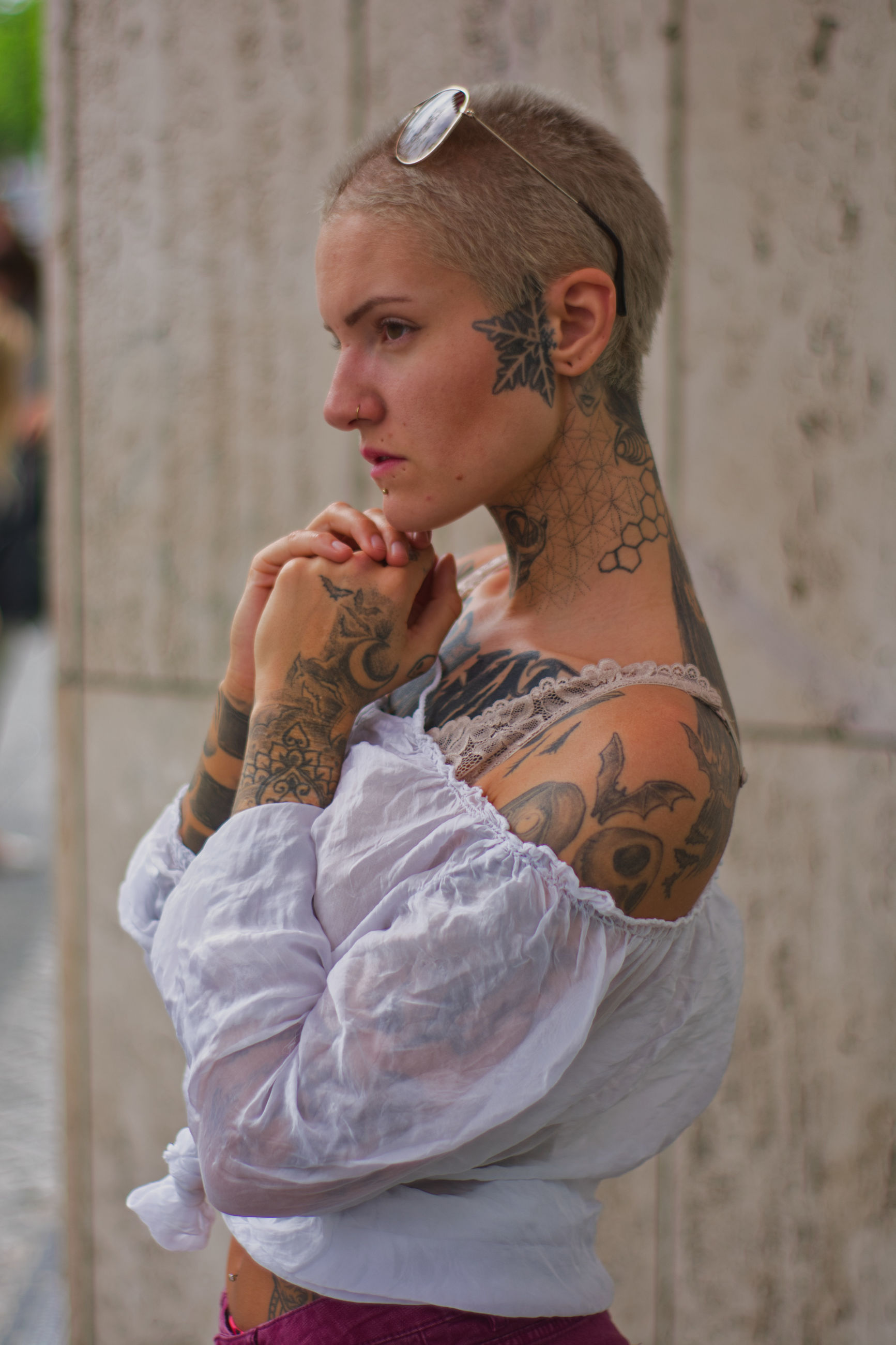 Side view of thoughtful tattooed woman looking away