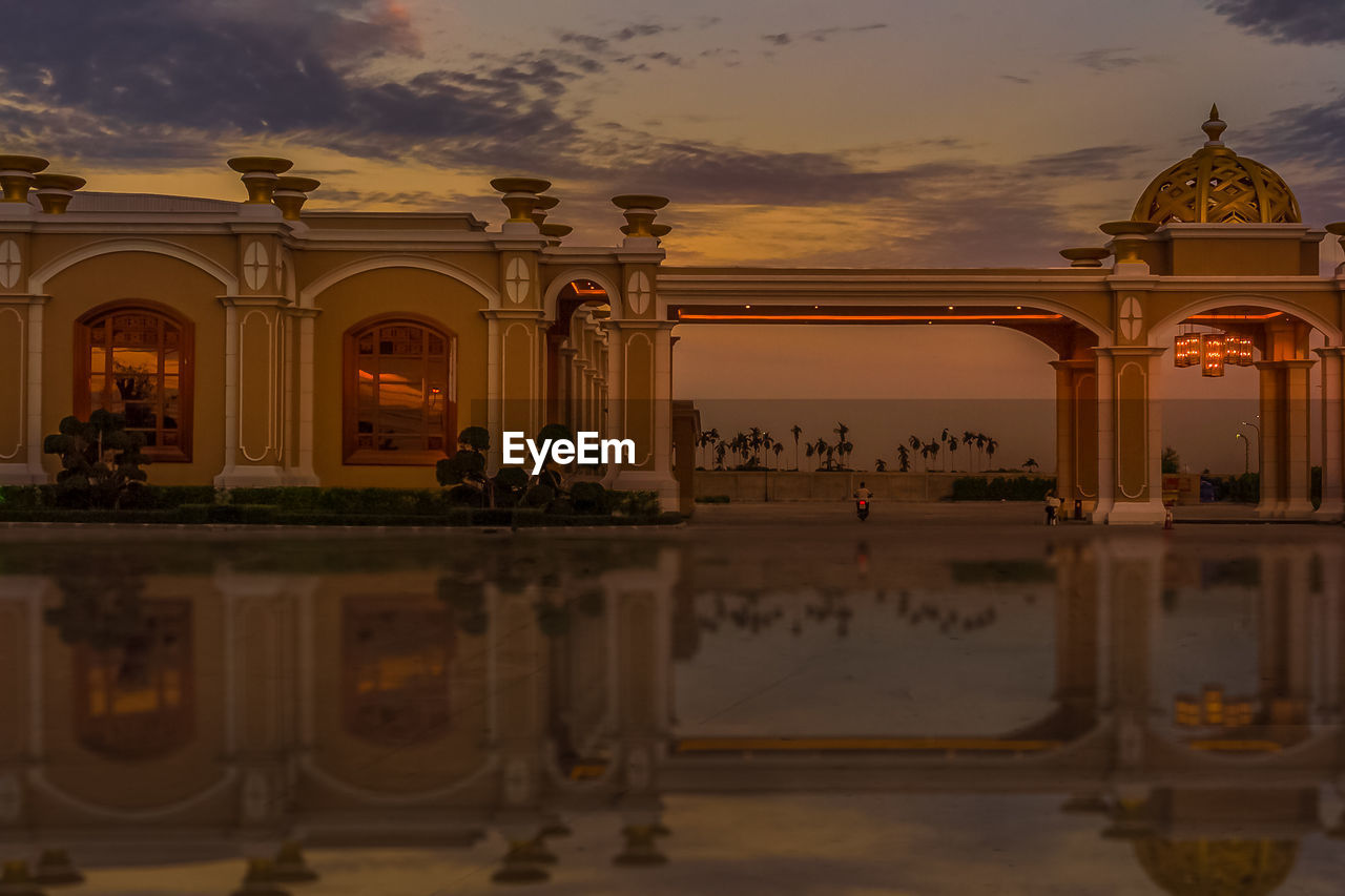 architecture, built structure, sky, building exterior, sunset, travel destinations, tourism, history, cloud - sky, the past, religion, place of worship, travel, nature, spirituality, architectural column, arch, belief, building, reflection, outdoors, luxury