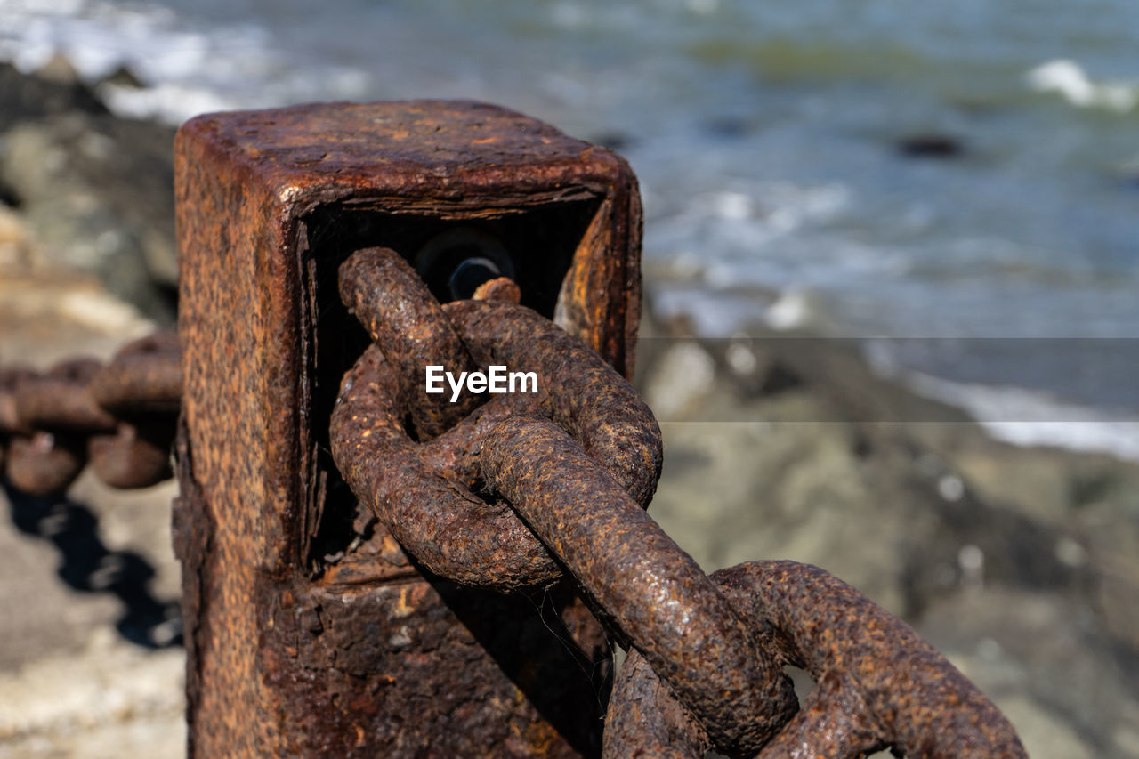 rusty, focus on foreground, metal, close-up, no people, day, weathered, old, solid, water, sea, textured, nature, land, beach, run-down, strength, decline, deterioration, rock, outdoors