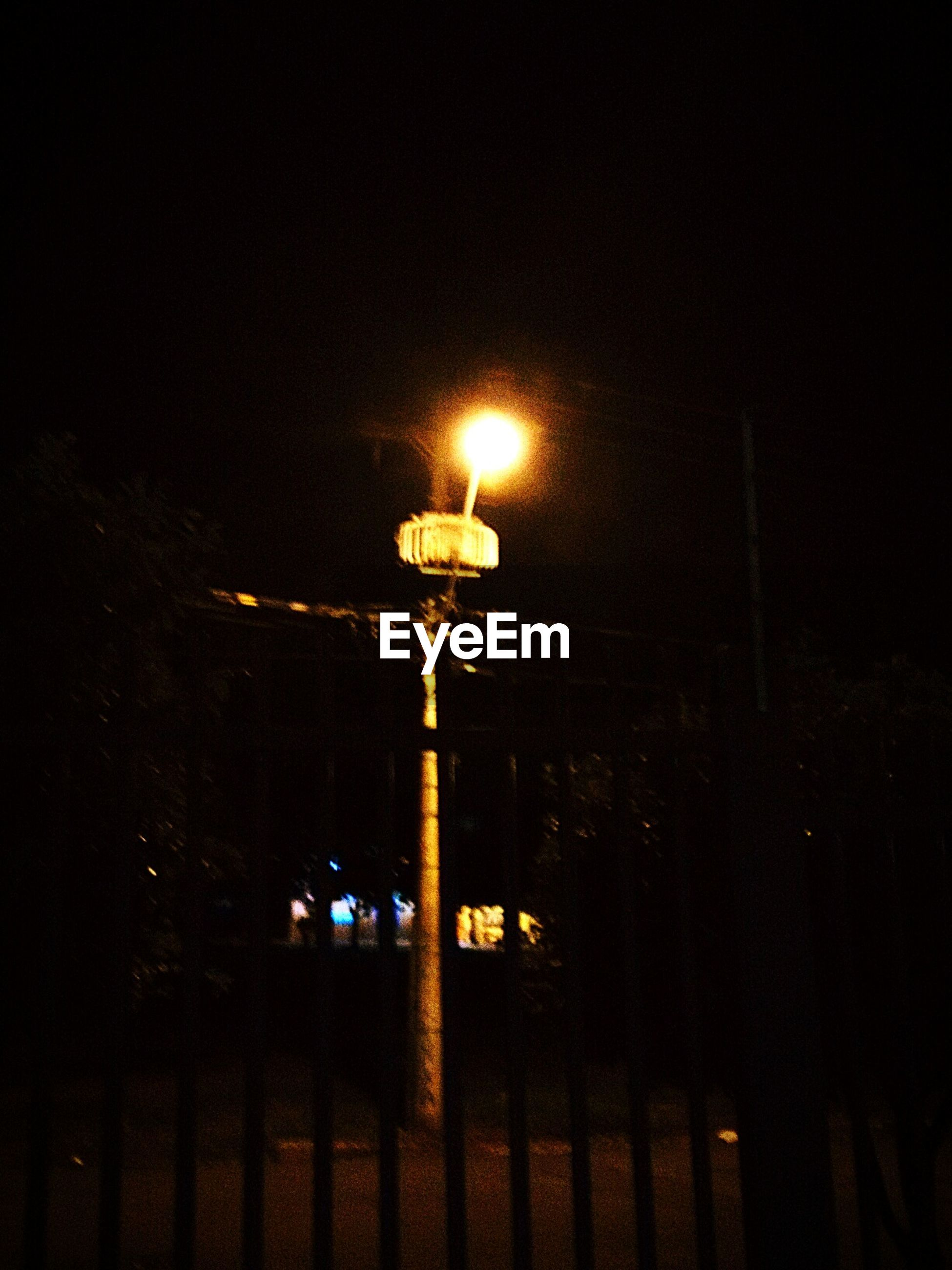illuminated, lighting equipment, night, street light, electricity, low angle view, electric light, sky, fuel and power generation, power line, dark, technology, light - natural phenomenon, silhouette, glowing, power supply, pole, no people, electricity pylon, outdoors