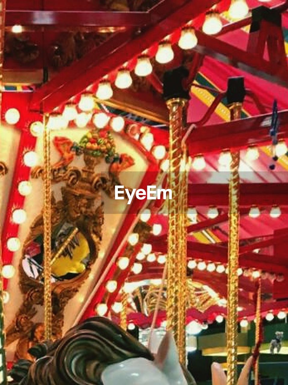amusement park, arts culture and entertainment, illuminated, carousel, fun, enjoyment, amusement park ride, night, close-up, no people, indoors