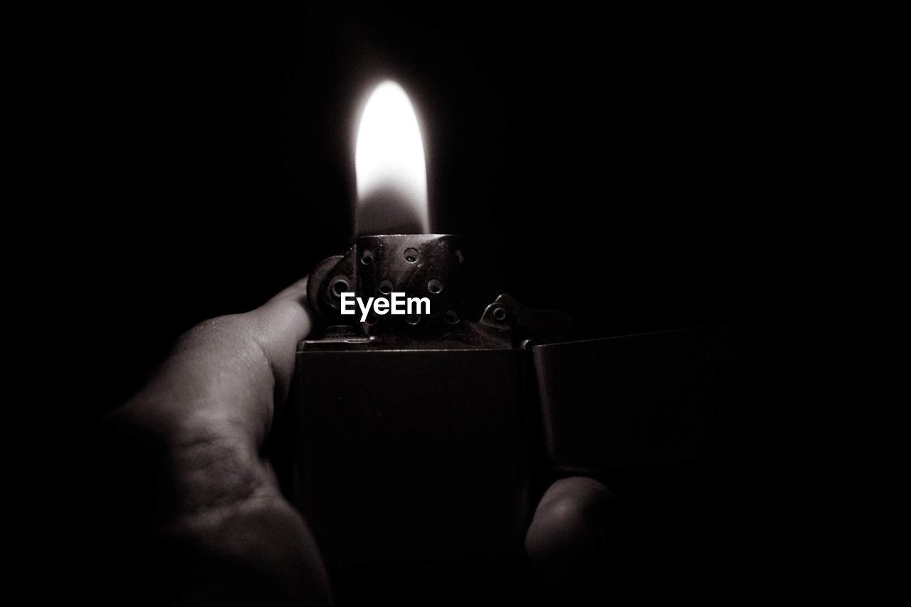 Close-up of hand holding cigarette lighter