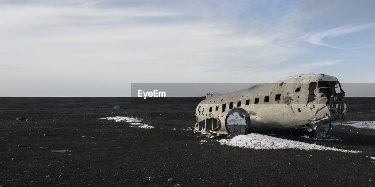 ABANDONED AIRPLANE ON SAND