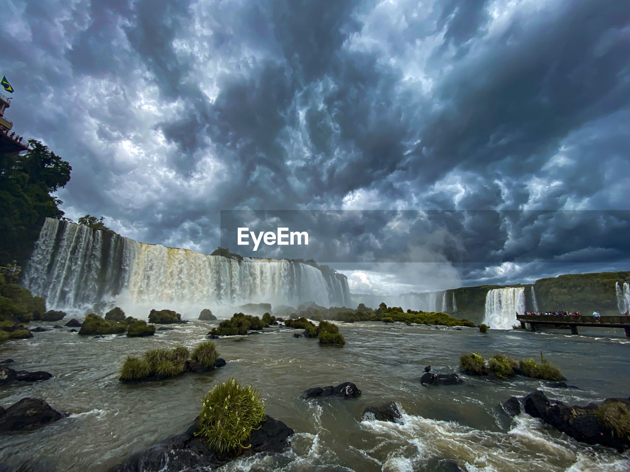 cloud - sky, water, sky, scenics - nature, beauty in nature, nature, rock, day, solid, storm, no people, sea, rock - object, storm cloud, land, overcast, tranquil scene, motion, outdoors, power in nature, flowing water, flowing