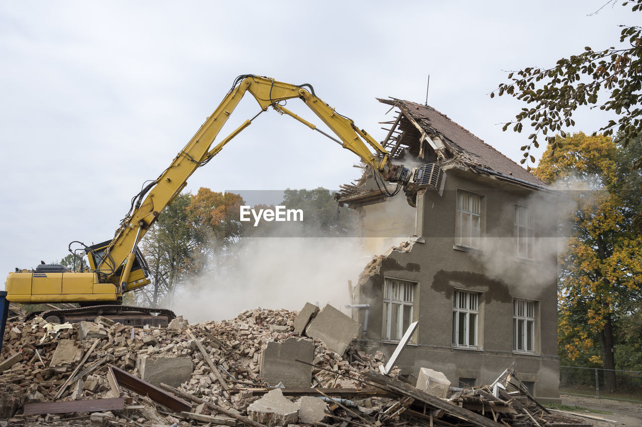 Machinery demolishing building