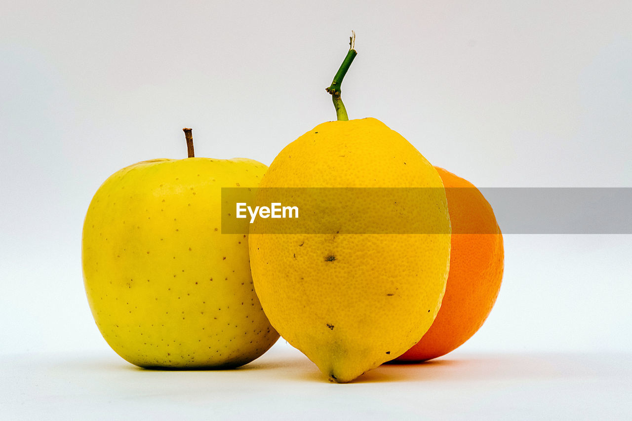 healthy eating, food, fruit, food and drink, wellbeing, freshness, white background, still life, studio shot, yellow, no people, close-up, indoors, pear, copy space, orange color, group of objects, ripe, cut out, plant stem, orange