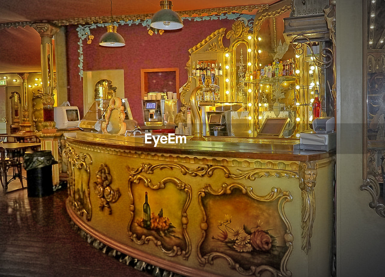 indoors, ornate, gold colored, no people, illuminated, luxury, gold, architecture, day, carousel