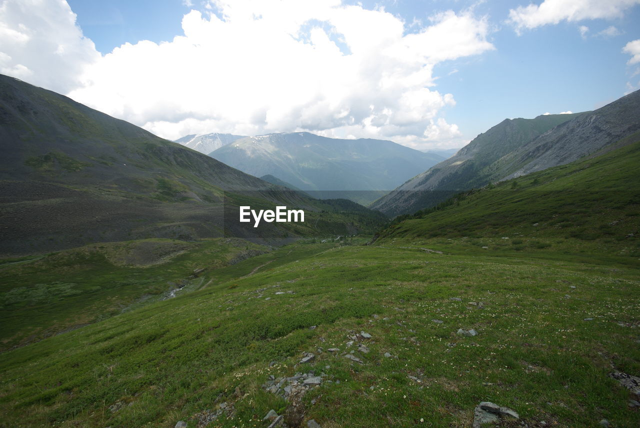 mountain, landscape, sky, beauty in nature, nature, scenery, day, outdoors, no people, wilderness, grass, scenics