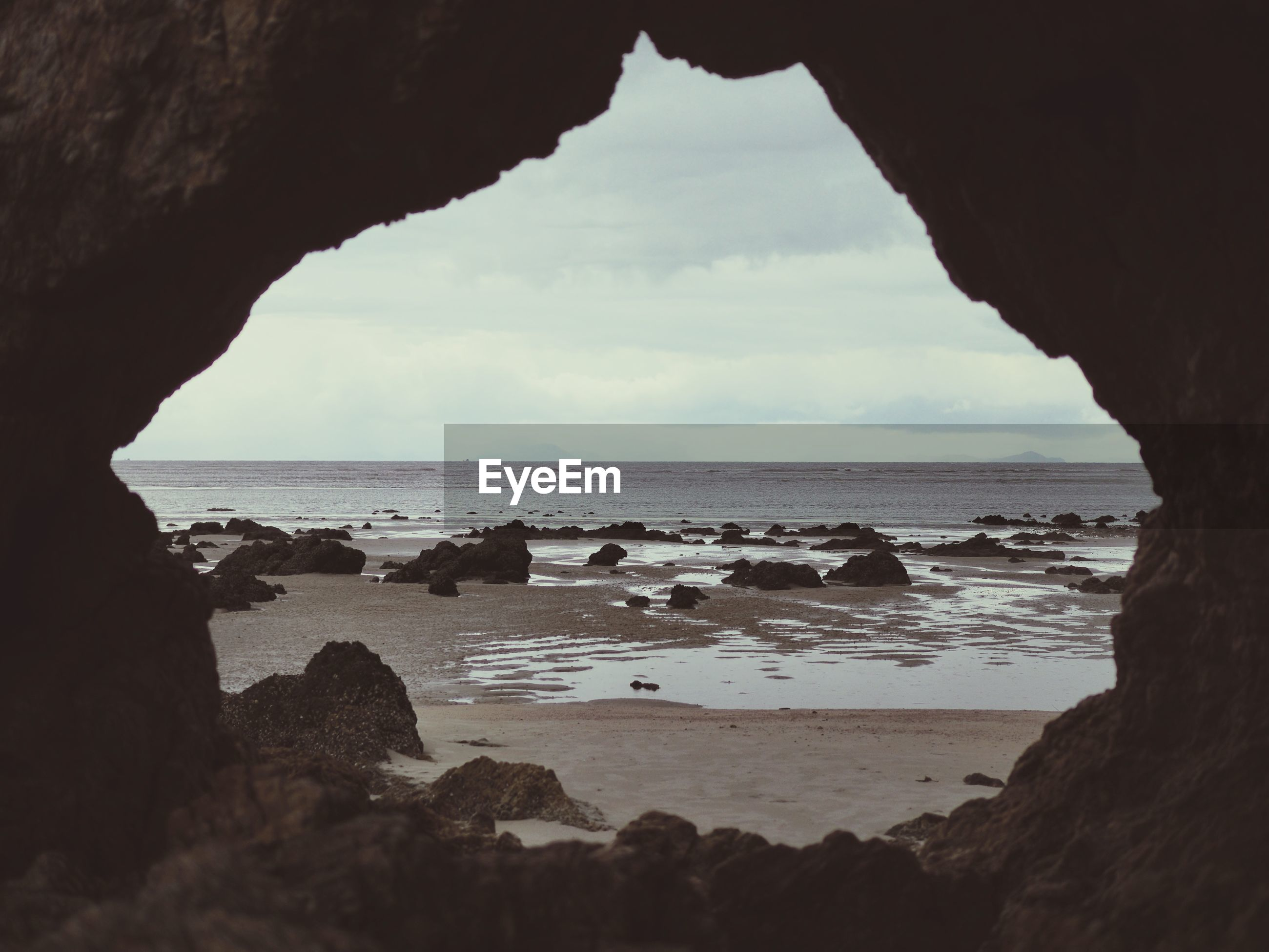 SCENIC VIEW OF SEA SEEN THROUGH ROCK FORMATION