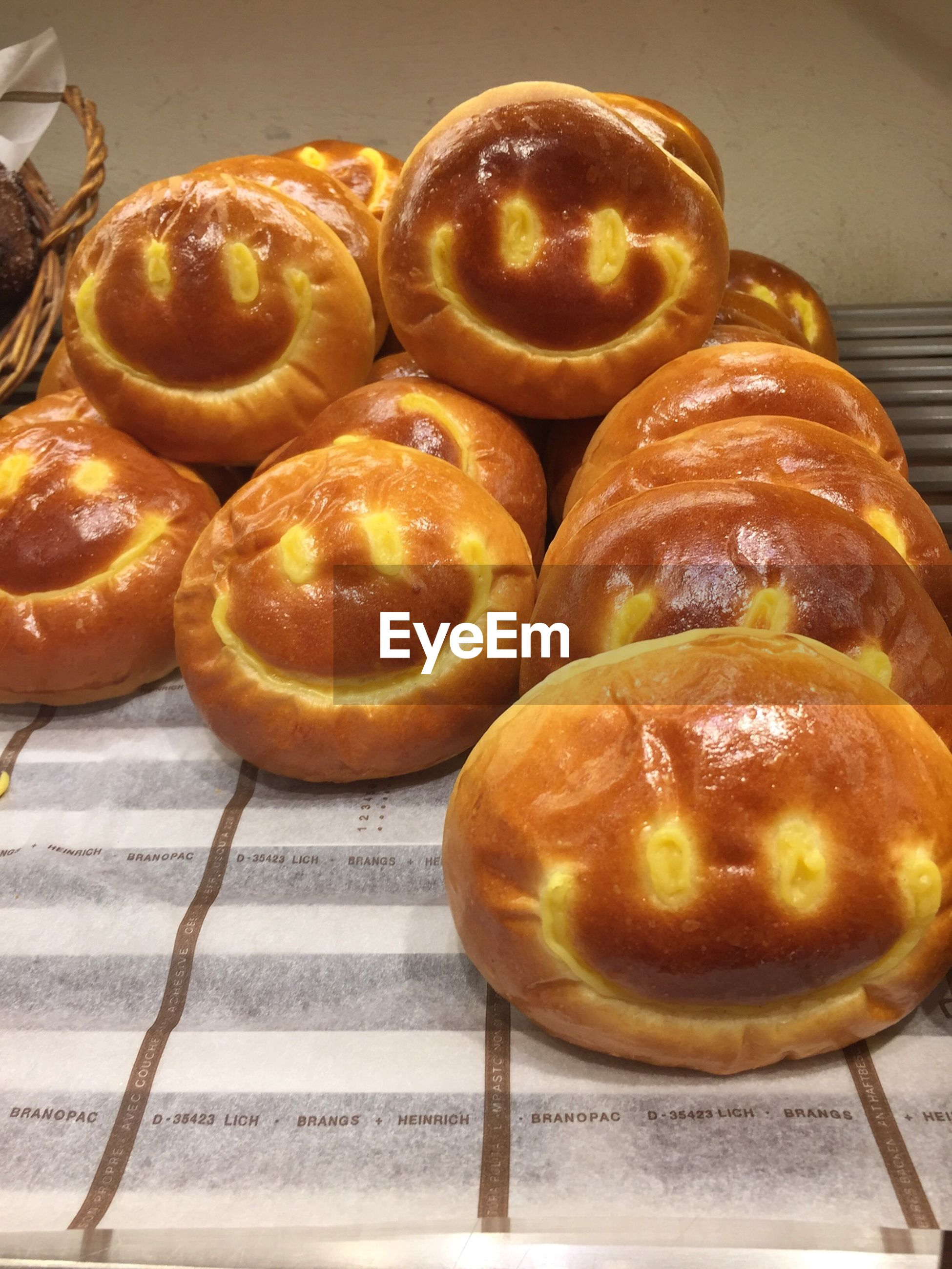 High angle view of smiley face buns on cooling rack