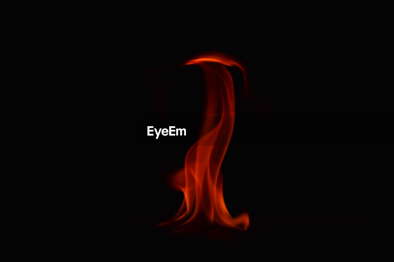 burning, heat - temperature, flame, studio shot, black background, smoke - physical structure, no people, red, close-up, motion, indoors, day