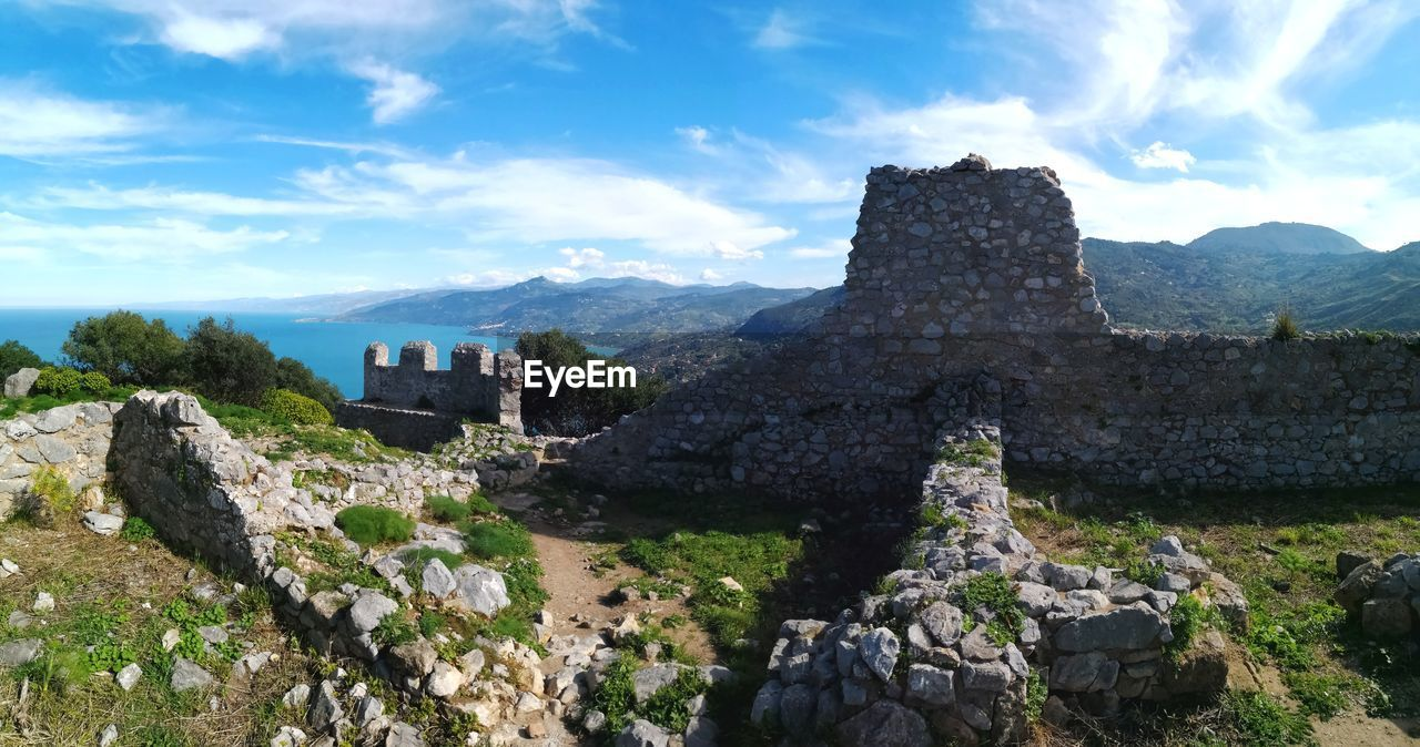 history, the past, architecture, sky, cloud - sky, built structure, ancient, nature, old ruin, solid, travel, day, ancient civilization, mountain, no people, tourism, travel destinations, rock, old, rock - object, outdoors, archaeology, ruined