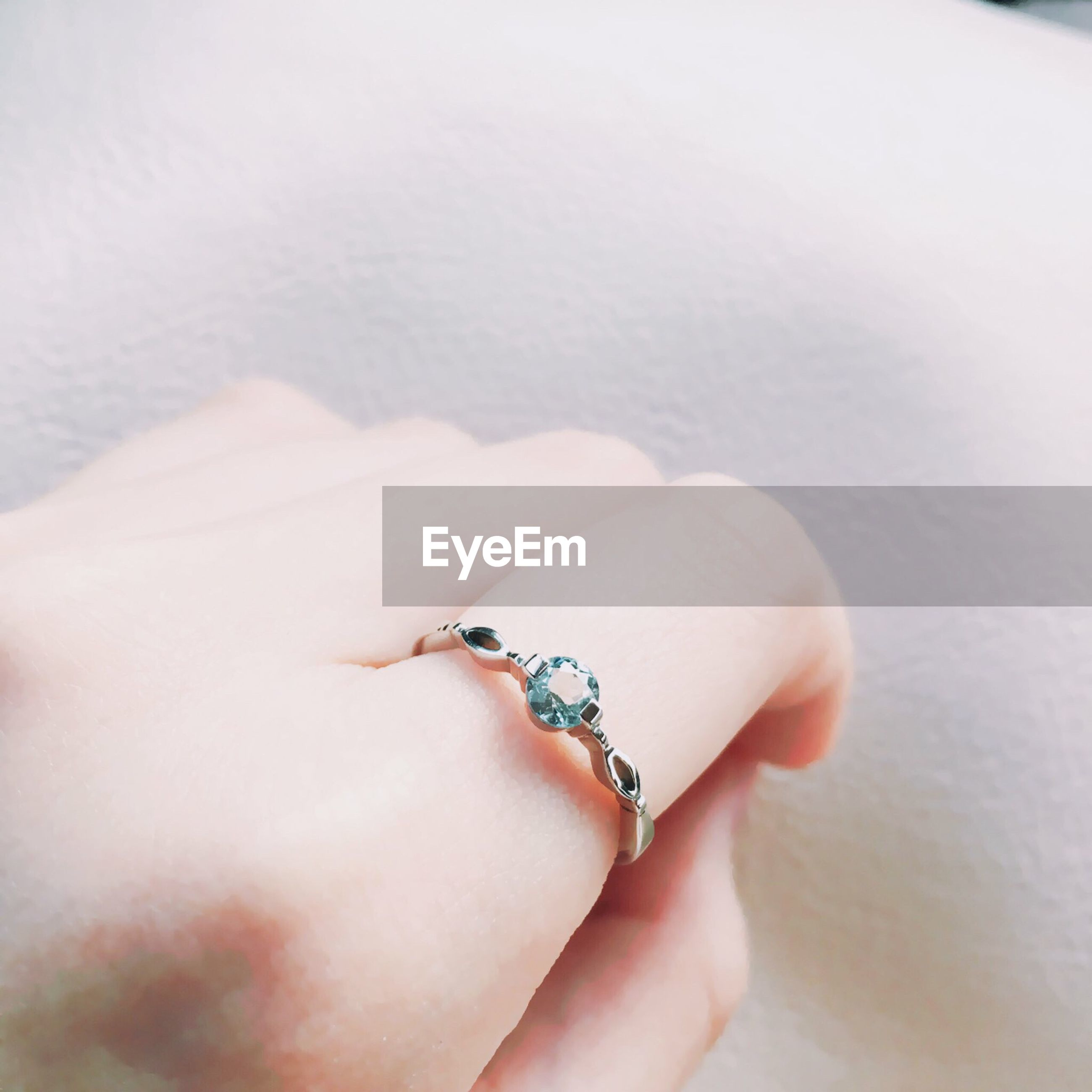 Cropped image of woman hand wearing diamond ring