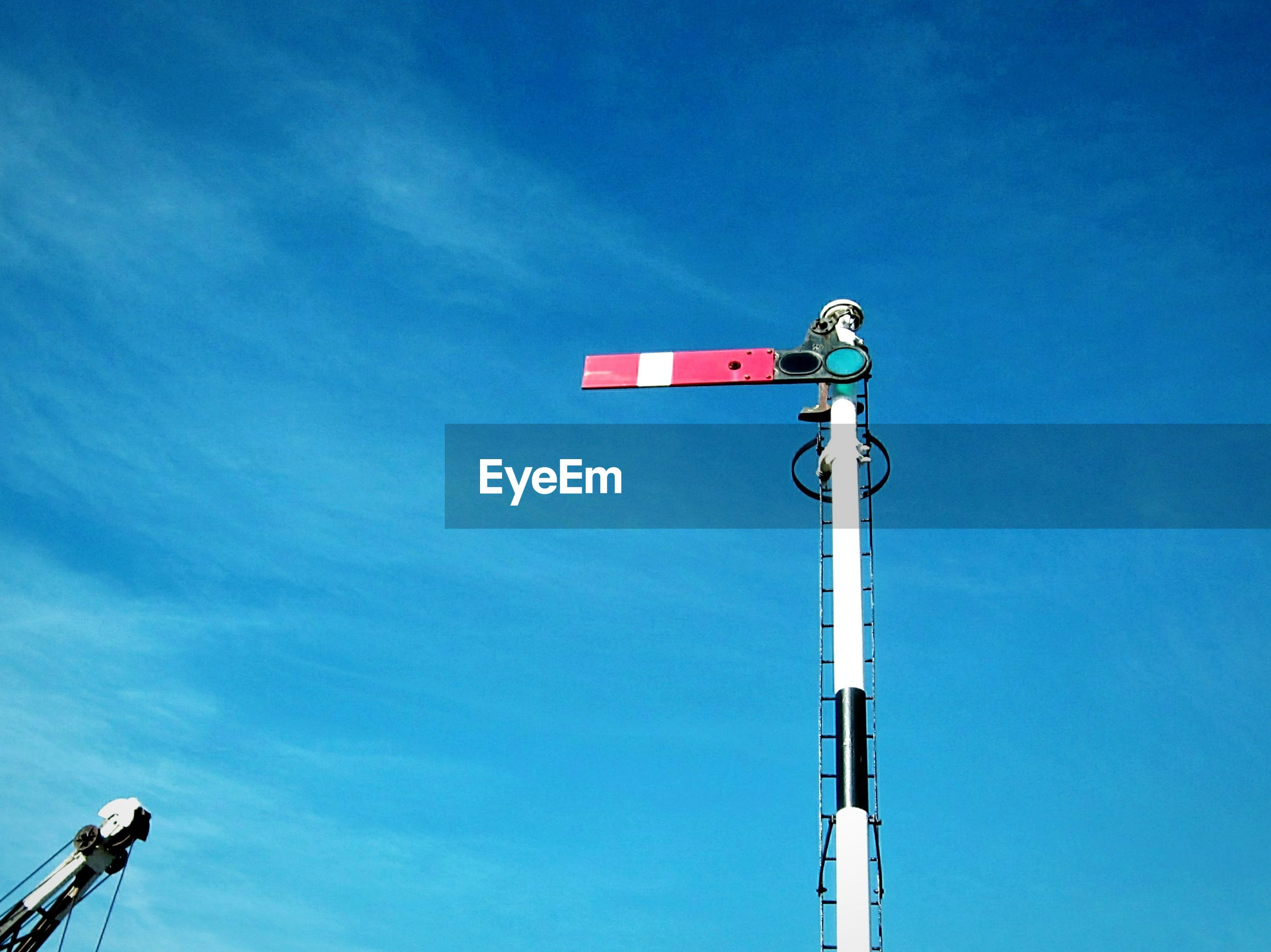 Low angle view of railway signal against sky