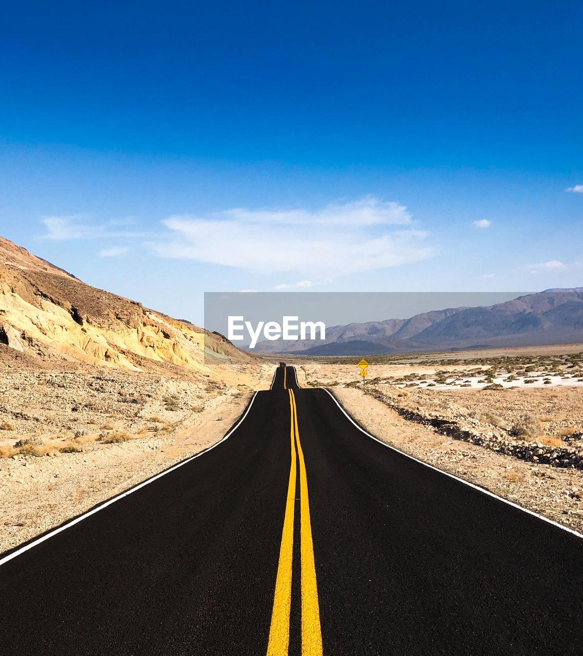 Empty Road At Desert Against Sky