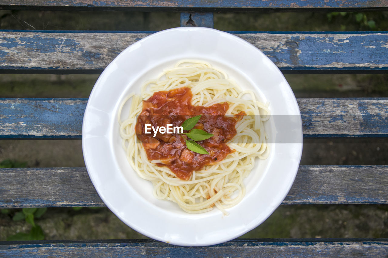 Directly Above Shot Of Spaghetti Served With Sauce In Plate On Table
