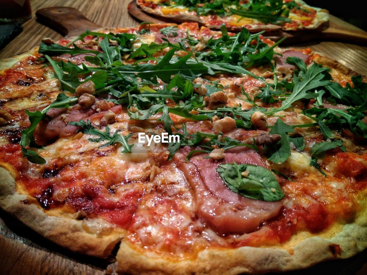 pizza, food and drink, food, freshness, unhealthy eating, ready-to-eat, indoors, still life, close-up, cheese, no people, vegetable, dairy product, table, italian food, herb, high angle view, meat, fast food, serving size, garnish, arugula, temptation, snack, pepperoni