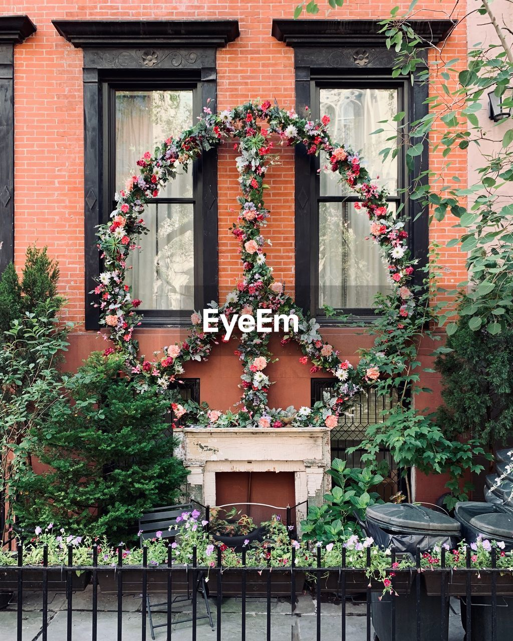 building exterior, built structure, architecture, plant, building, day, no people, flower, multi colored, flowering plant, nature, decoration, growth, window, outdoors, low angle view, house, potted plant, celebration, art and craft, flower pot