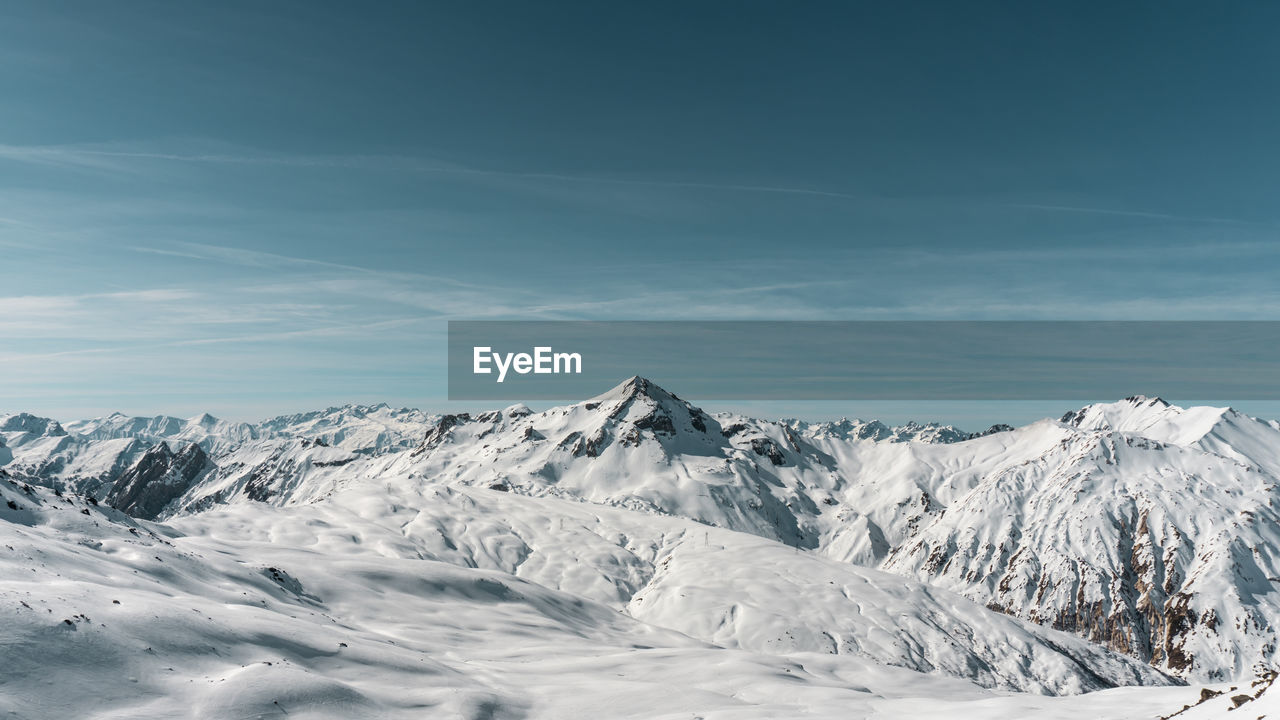 cold temperature, mountain, scenics - nature, winter, sky, snow, beauty in nature, tranquil scene, snowcapped mountain, cloud - sky, tranquility, environment, non-urban scene, day, landscape, nature, mountain range, no people, white color, mountain peak