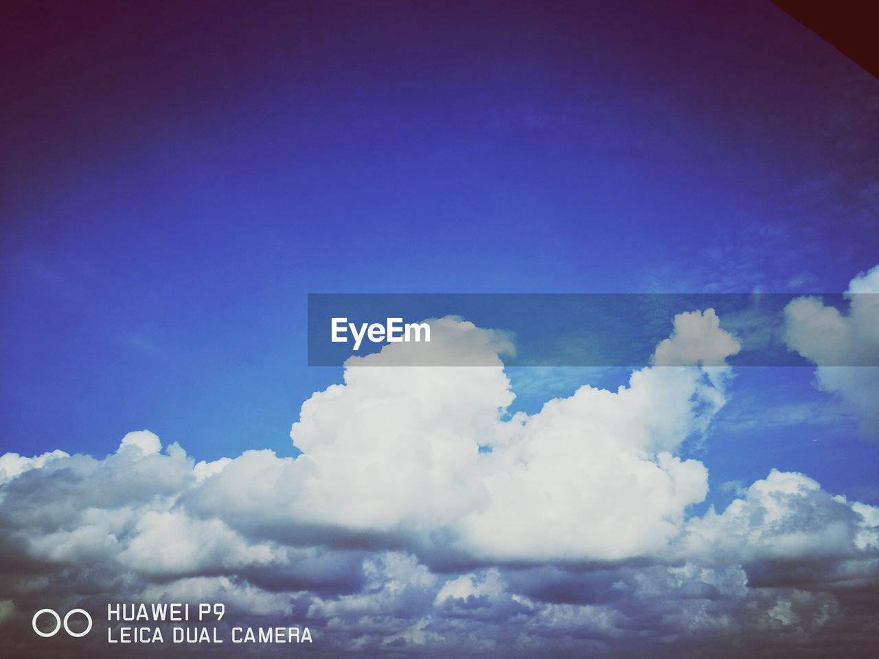 cloud - sky, sky, text, communication, blue, low angle view, day, no people, outdoors, nature