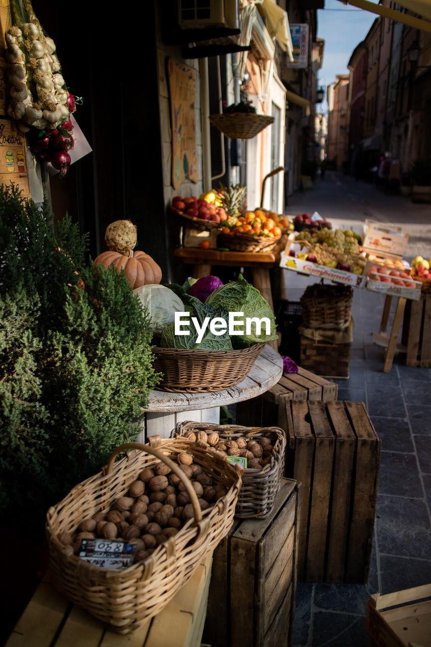 Vegetables in baskets for sale at market stall