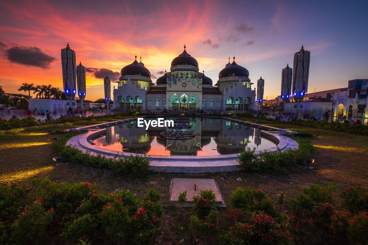 architecture, built structure, building exterior, sky, water, sunset, building, nature, dome, cloud - sky, tourism, travel destinations, place of worship, travel, plant, the past, religion, spirituality, reflection, no people, outdoors, government